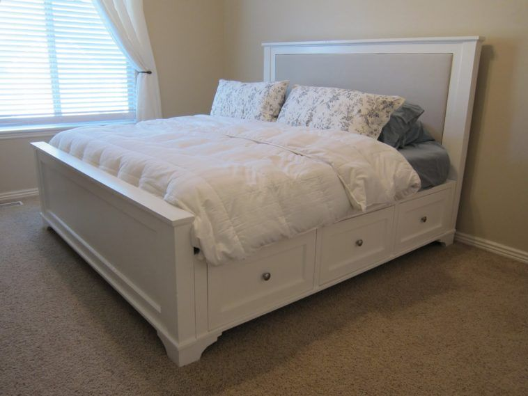 White Wooden Kingsize Bed With Storage Drawer And Headnboard Using Grey Upholstered Panel Bedding Combined Curtain Cream