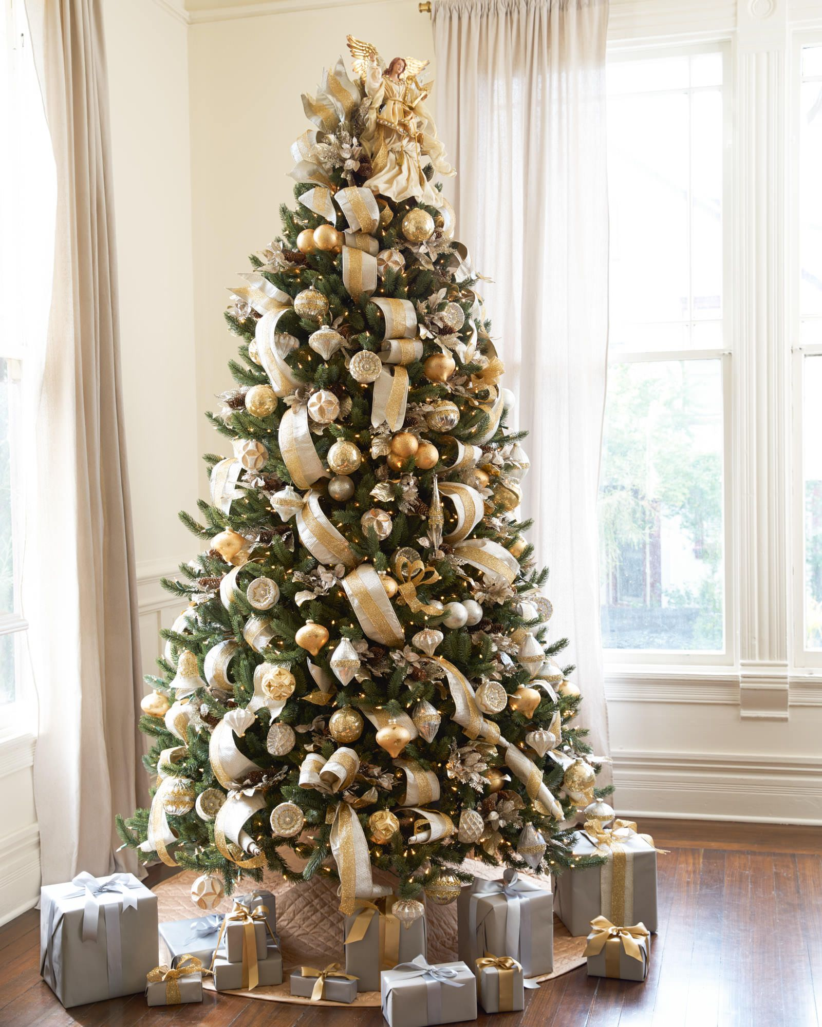Video The Silver And Gold Christmas Tree Theme Was Created Using Balsam Hill S Silver Elegant Christmas Trees Gold Christmas Decorations Silver Christmas Tree