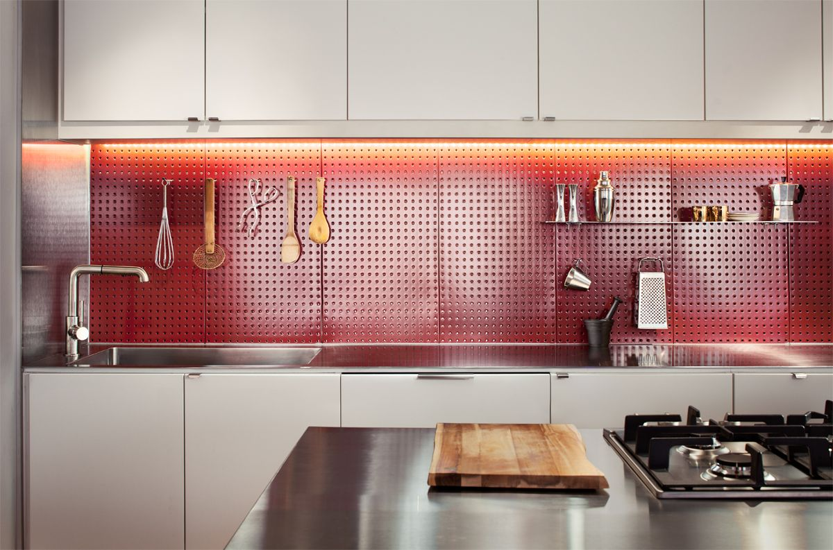wonderful Stainless Steel Pegboards Part - 18: Loft kitchen with steel pegboard backsplash, stainless steel counter,  exposed brick, and white cabinets. Photo by Matt Delphenich.