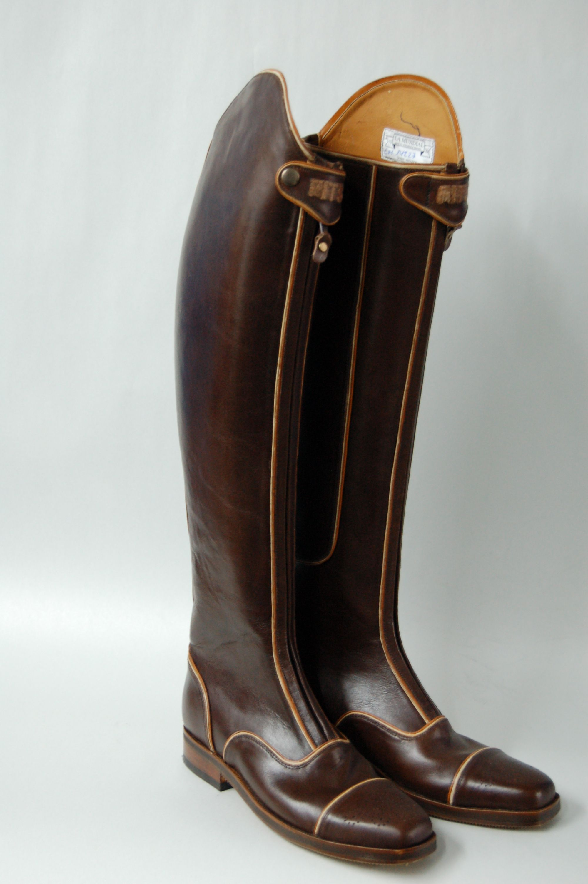 Custom La Mundial Boots made specifically for schooling - brown with white and tan piping and cap toes