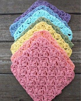 Crochet a rainbow array of these cheerful dishcloths for a splash of springtime color.