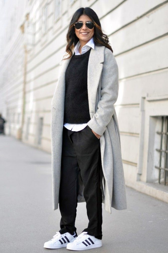 cheaper de8e8 726a2 Street Style  All black flowing maxi dress + cape ensemble worn with black  and white Adidas sneakers.