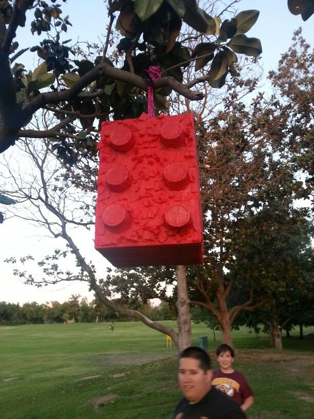Lego pinata I made out of a cereal box, red solo cups and streamer! Easy peasy