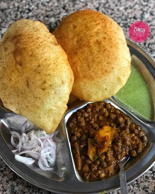 """""""What more can I ask for on a Saturday Morning? A big plate full of Chole and fluffy bhature. Had it in a small shop in khirki extension for ₹40 per plate. . . Follow @ZingyZest to stay updated to know whats buzzing in your city. ❤ All locations and info on my Snapchat- SnapZingyZest 👻 . . . #ZingyZest #Foodblogger #foodcoma #Delicious #cholebhature #picoftheday  #like4like #likesforlikes #delhi #delhigram #f52grams #Foodphoto #all_shots #foodlove #foodpics #eeeeeats #food  #yummyfood…"""