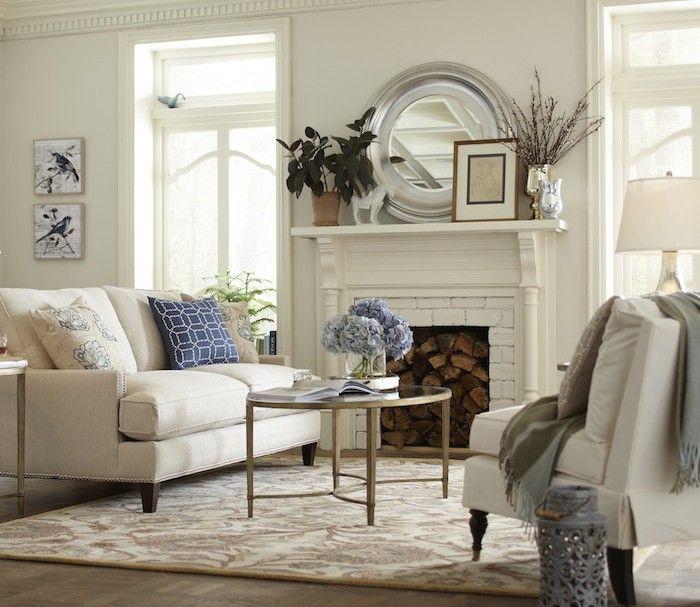 Subtle blue accents complement this creamy white #livingroom