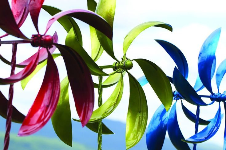 "Green Feather Wind Spinner, 22  is part of lawn Sculpture Wind Spinners - Green Feather Wind Spinner, 22  Lively motion and a bright finish make our 22"" Green Feather Spinner a marvelous choice for your lawn or garden  This colorful kinetic sculpture spins cheerfully as breezes blow, adding greater dimensionality to your landscape  Like other Happy Gardens spinners, this one has been individually handcrafted, and will bring lasting beauty to your lawn, garden, or outdoor living space   Steel construction; green finish  Dimensions 22"" W x 72"" H  Weight 10 lbs  Imported"