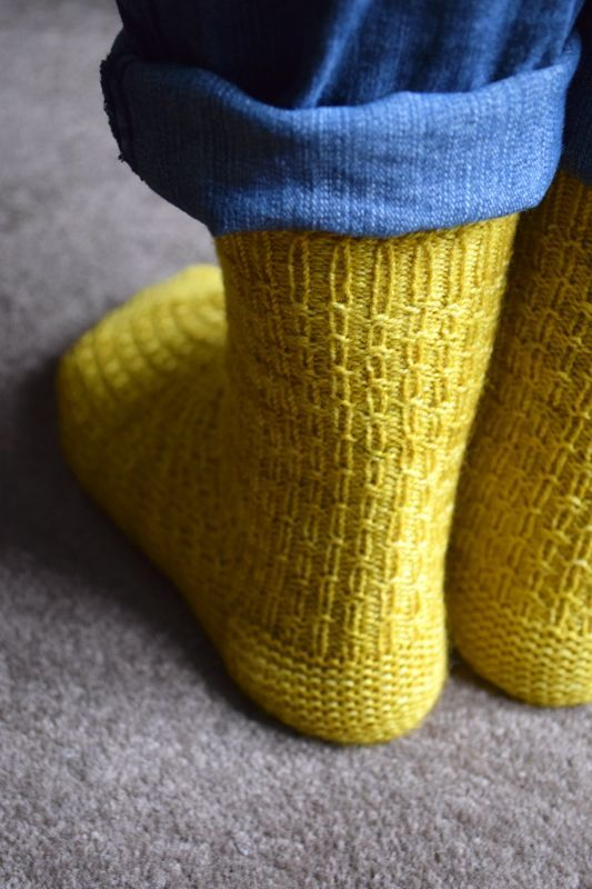 Reasons to be Cheerful socks by Rachel Atkinson