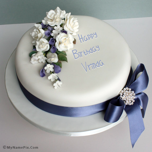 the name vrinda is generated on elegant happy birthday cake with name image