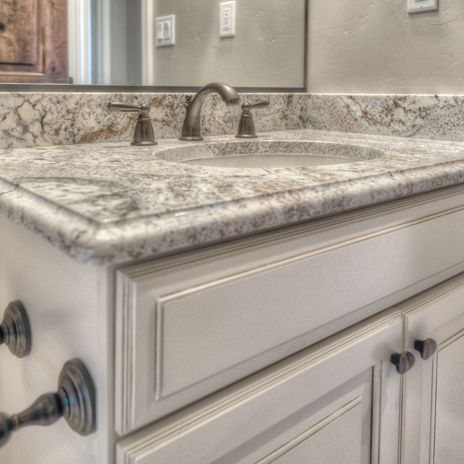 Arizona Tile Carries White Springs In Natural Stone Granite Slabs  Consisting Of A White Background With Burgundy And Gray Movement.