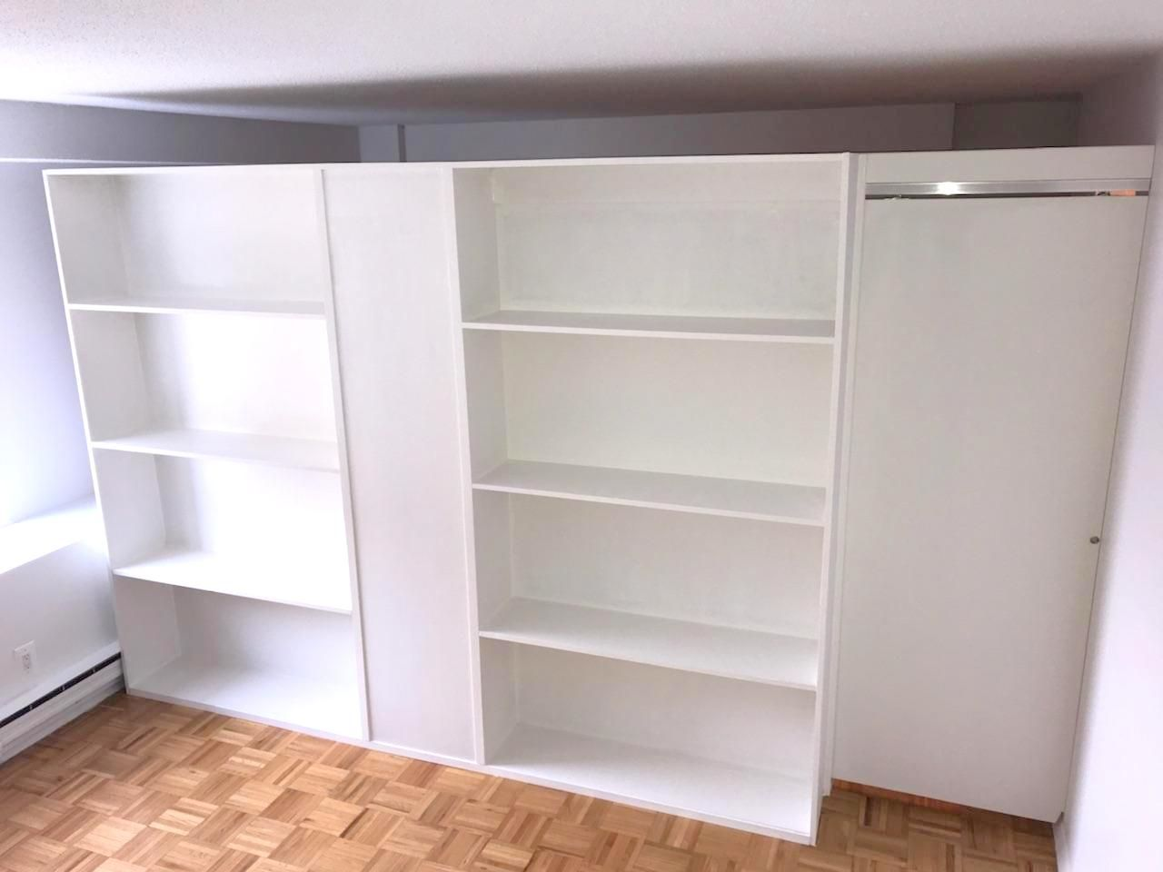 Freestanding Bookcase Wall With Sliding Door Call Us For All Your Custom Room Partition And Storage Inquiries 646 837 7300
