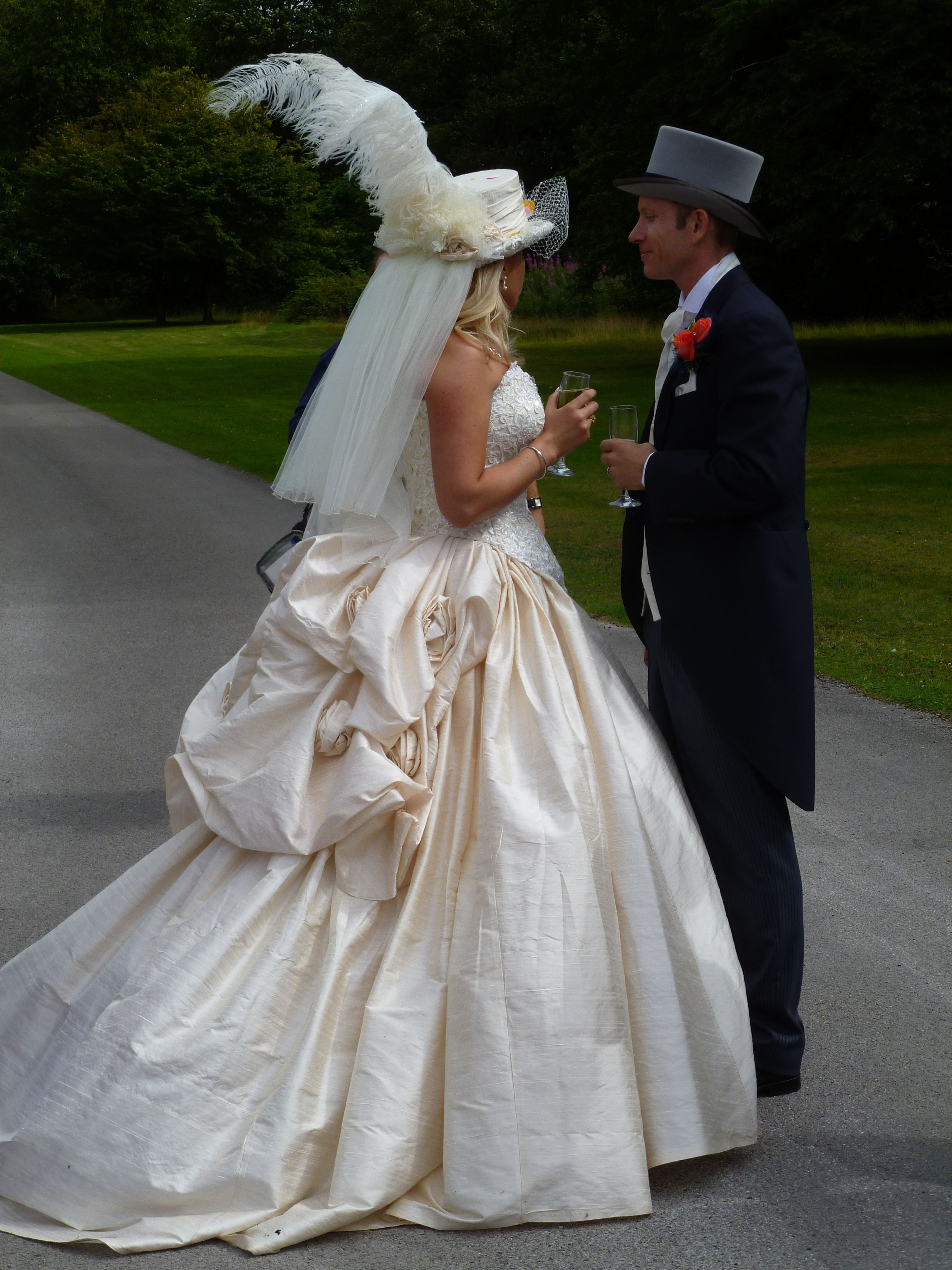 Victorian silk top hat and wedding dress dellton.co.uk
