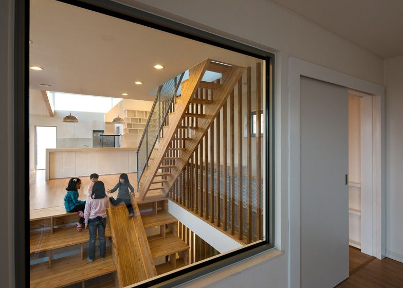 House In South Korea By Moon Hoon With A Wooden Indoor Slide Slotted Into A  Combined Staircase And Bookshelf.