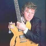 """David William """"Dave"""" Edmunds (born 15 April 1944) is a Welsh singer, guitarist and record producer. Although he is primarily associated with pub rock and New Wave, and had numerous hits in the 1970s and early 1980s, his natural leaning has always been towards 1950s style rock and roll."""
