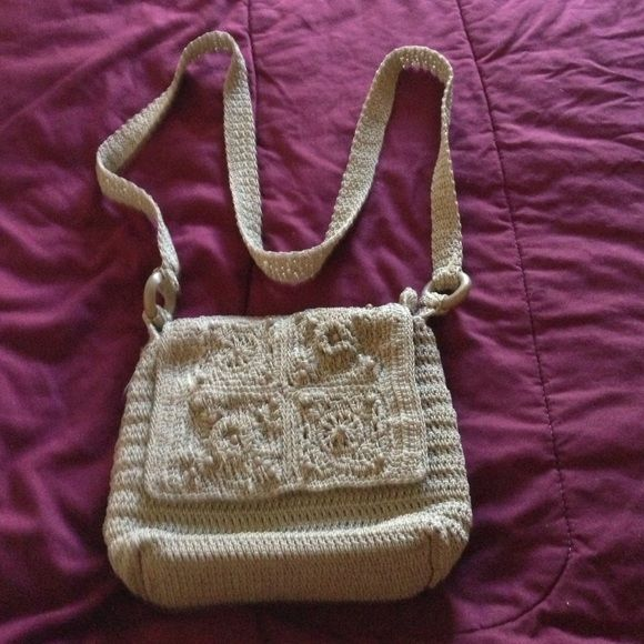 "Taupe crochet crossbody bag Fully lined bag. Strap is approximately 52"" long w/ a drop of about 26"". Body opens with zipper under the flap. There is another zippered pocket inside. The zipper pocket on the back has card slots, and yet another zipper pocket inside. Measurements of the bag are 7""x9 1/2"" x 2 1/2"". Make a reasonable offer. Bags Crossbody Bags"