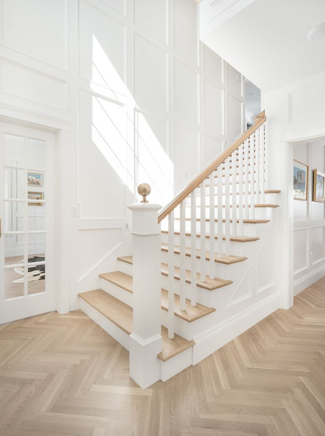 Foyer wall paneling and herringbone hardwood floor Crisp white foyer ...