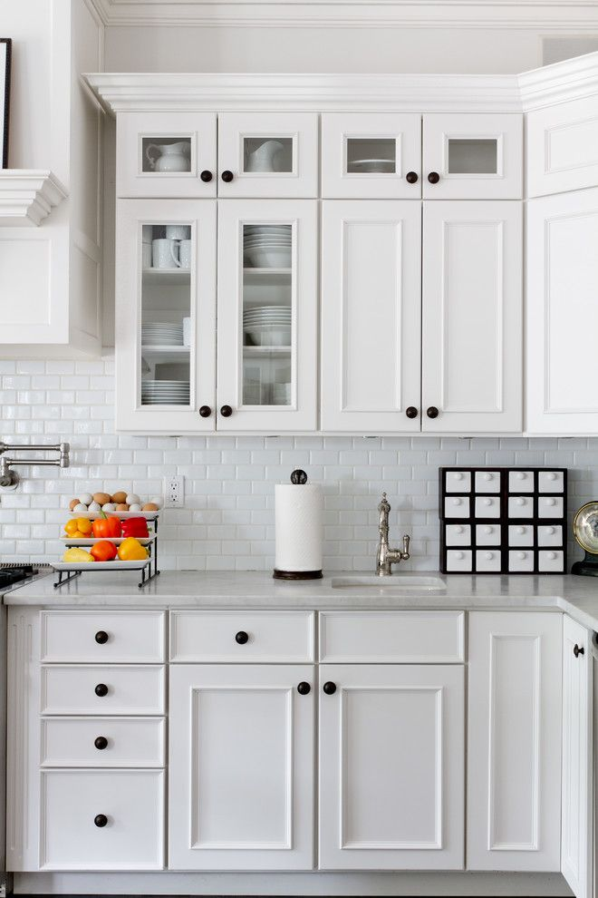 Small subway tile in kitchen traditional with black for White kitchen cabinets black hardware