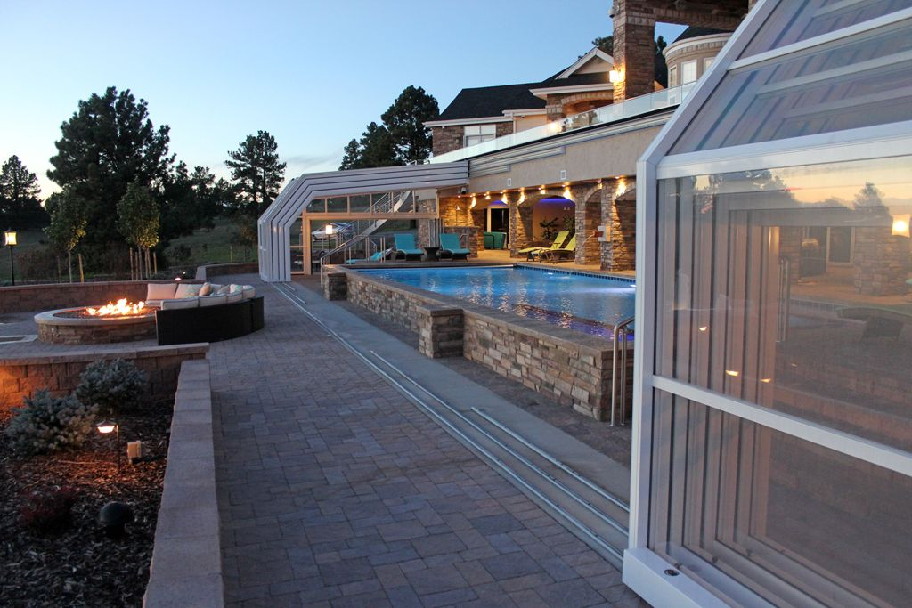 Retractable Pool Enclosure Makes For Year Round Swimming Indoor Pool Design Indoor Swimming Pool Design Pool Enclosures
