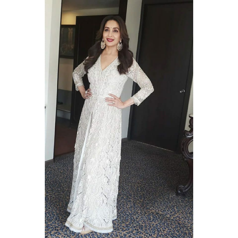 Stunning Actress Host Madhuri Dixit Nene In Pearl White Color Floor Length Dress With With Hand Embroid With Images Madhuri Dixit Wedding Dresses Lace Floor Length Dresses