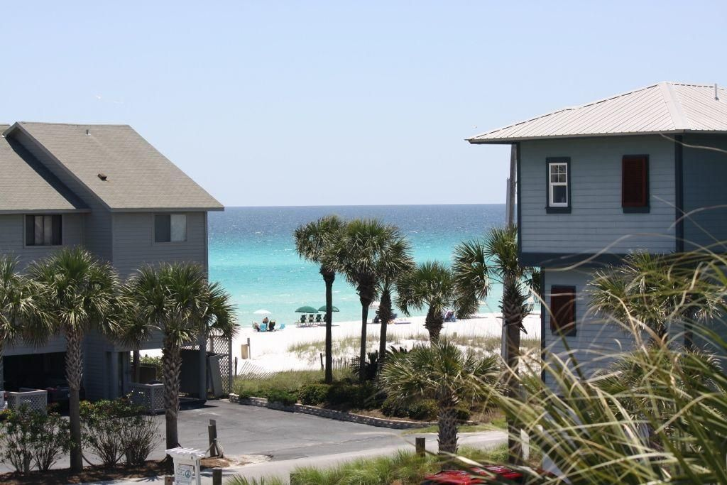 Another balcony view with palms Beach vacation rentals