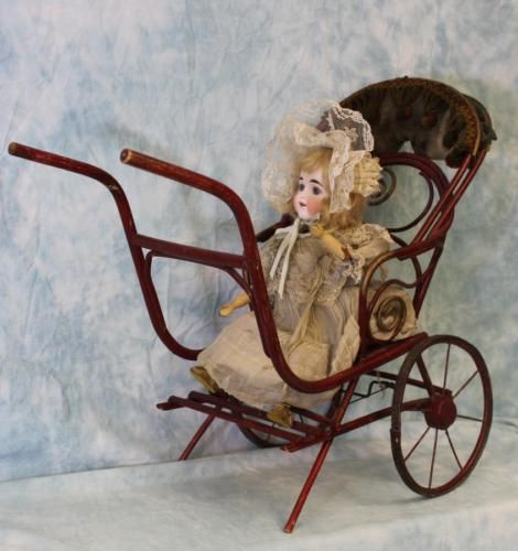 German-automaton-Bisque-Doll-in-Bent-wood-buggy-waves-hands-turns-head-All-Orig