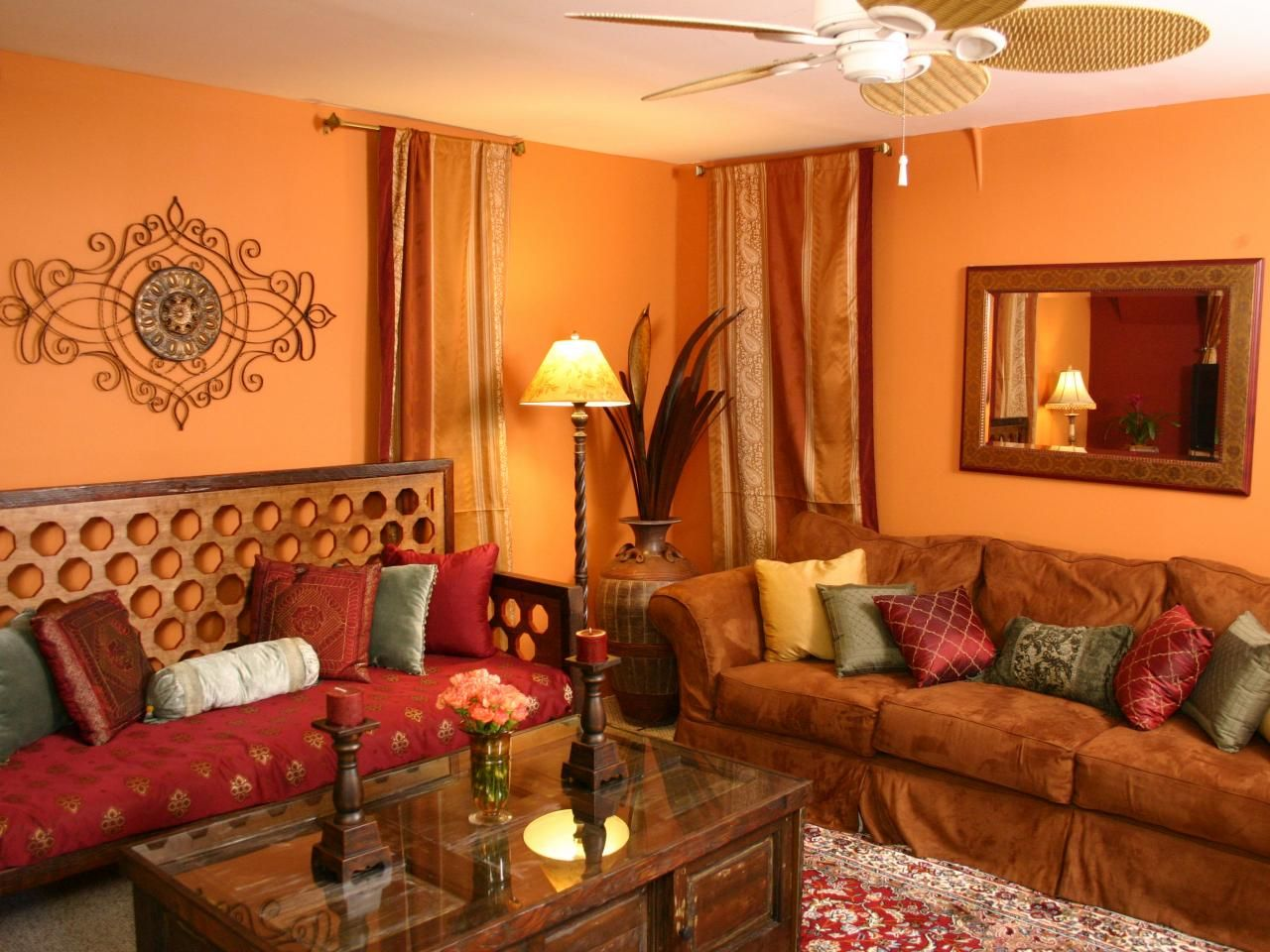 This Eclectic Living Room Features A Rich Orange And Red Color Palette,  Making The Space