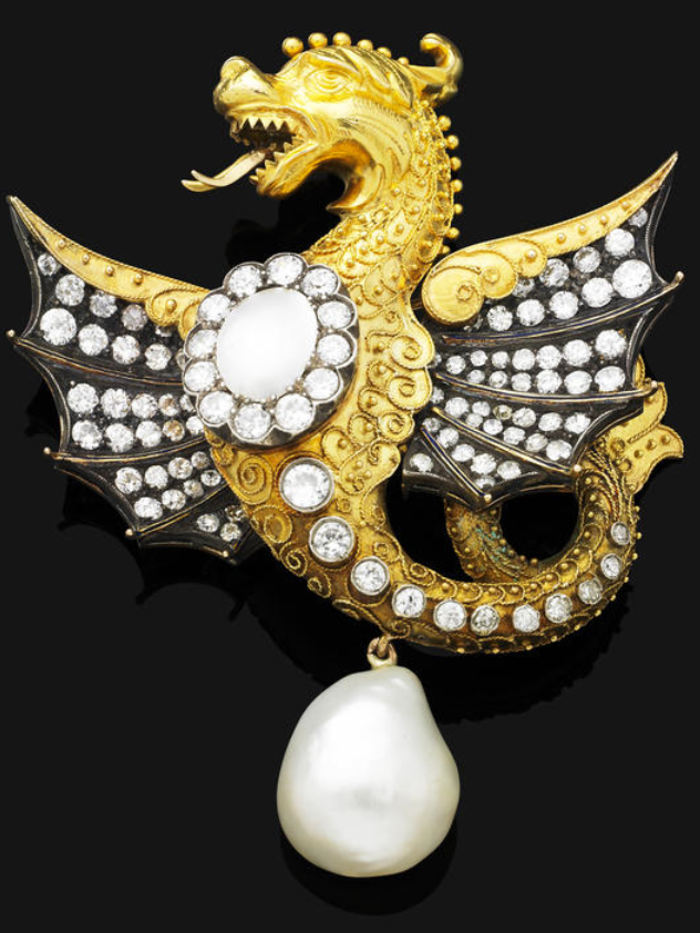 A natural pearl and diamond brooch  Sculpted as a 'Griffin', the outstretched, blackened wings set with circular-cut diamonds, the body, mounted with a central blister pearl and diamond cluster, with applied gold bead and wirework decoration, the tail accented by a series of graduated diamond collets, suspending a baroque-shaped natural pearl drop measuring approximately 16.57 x 14.90 x 11.56mm mounted in yellow gold, blister pearl untested, diamonds approximately 3.00 carats total, length…