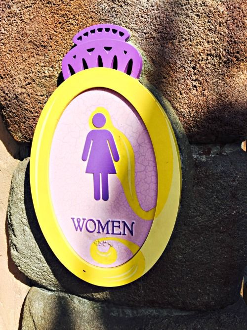 I'm one of those moms who pulls out my camera in a Disney restroom. WHAT? Yes - let me take you into my favorite - Tangled Themed Restroom at Disney World.