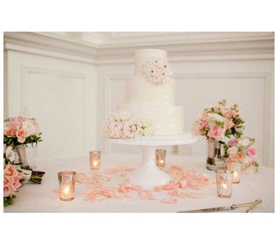 simple wedding cake table decoration get double duty out of bridesmaids bouquets