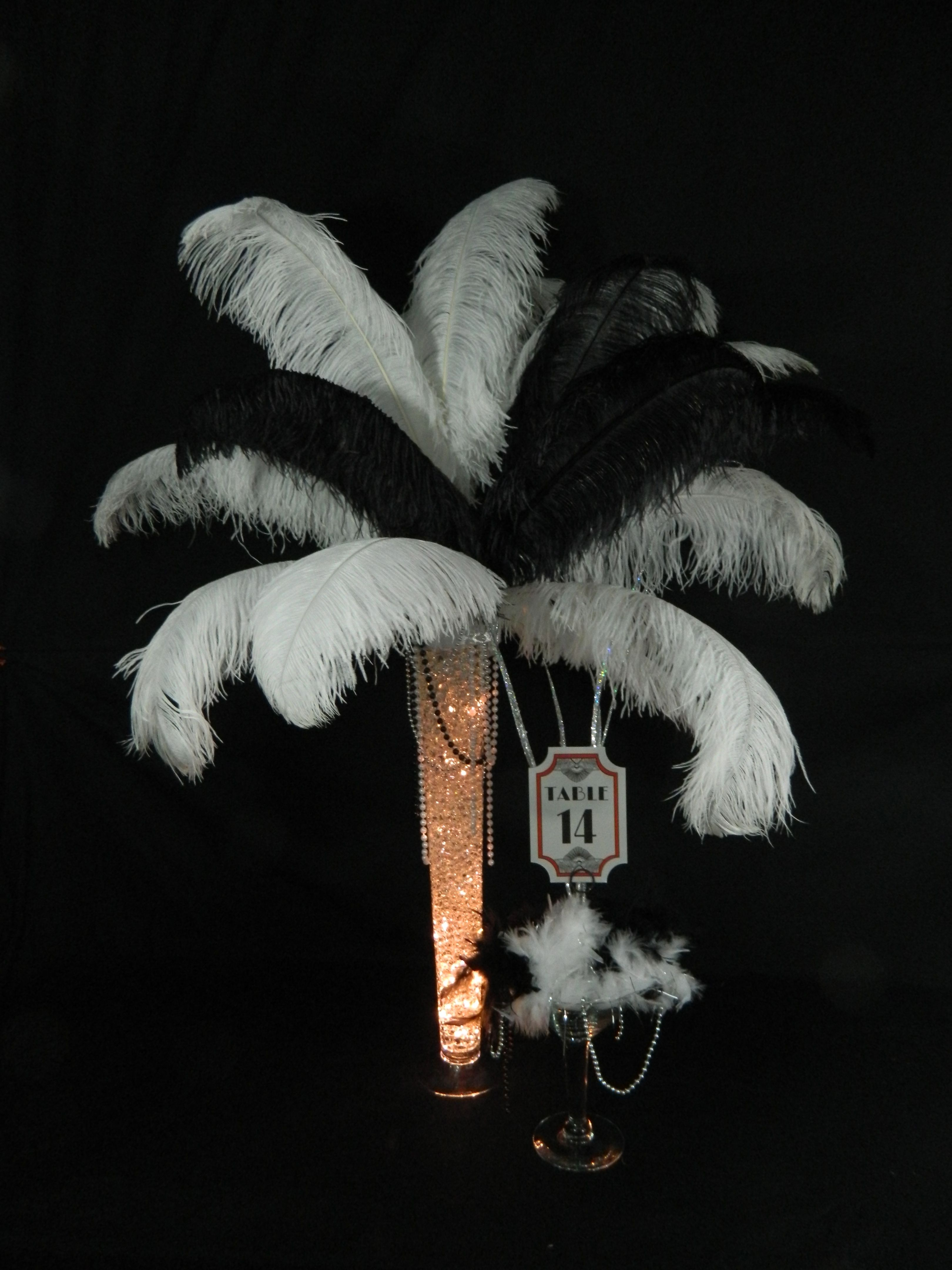 Ostrich feather centerpieces and table markers used for ...