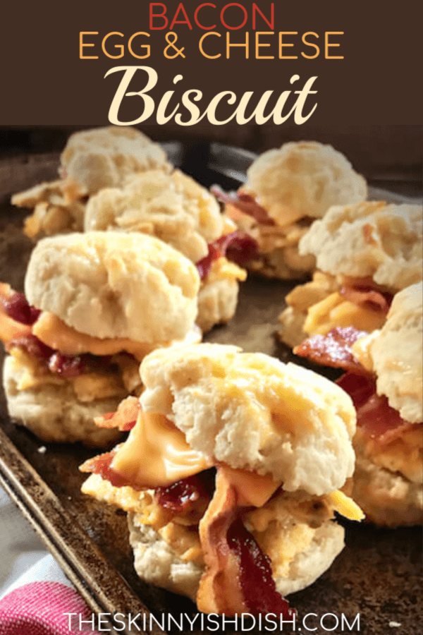When you're looking for the perfect grab and go, taking a little time to make ahead these freezer friendly Bacon, Egg & Cheese Biscuits will result in delicious, efficient and satisfied mornings.  A freezer full of ready to heat breakfast sandwiches is a huge meal prep win for busy mornings! #theskinnyishdish #bacon #egg #cheese #biscuits #freestylesmartpoints #weightwatchers #ww #eggmeals
