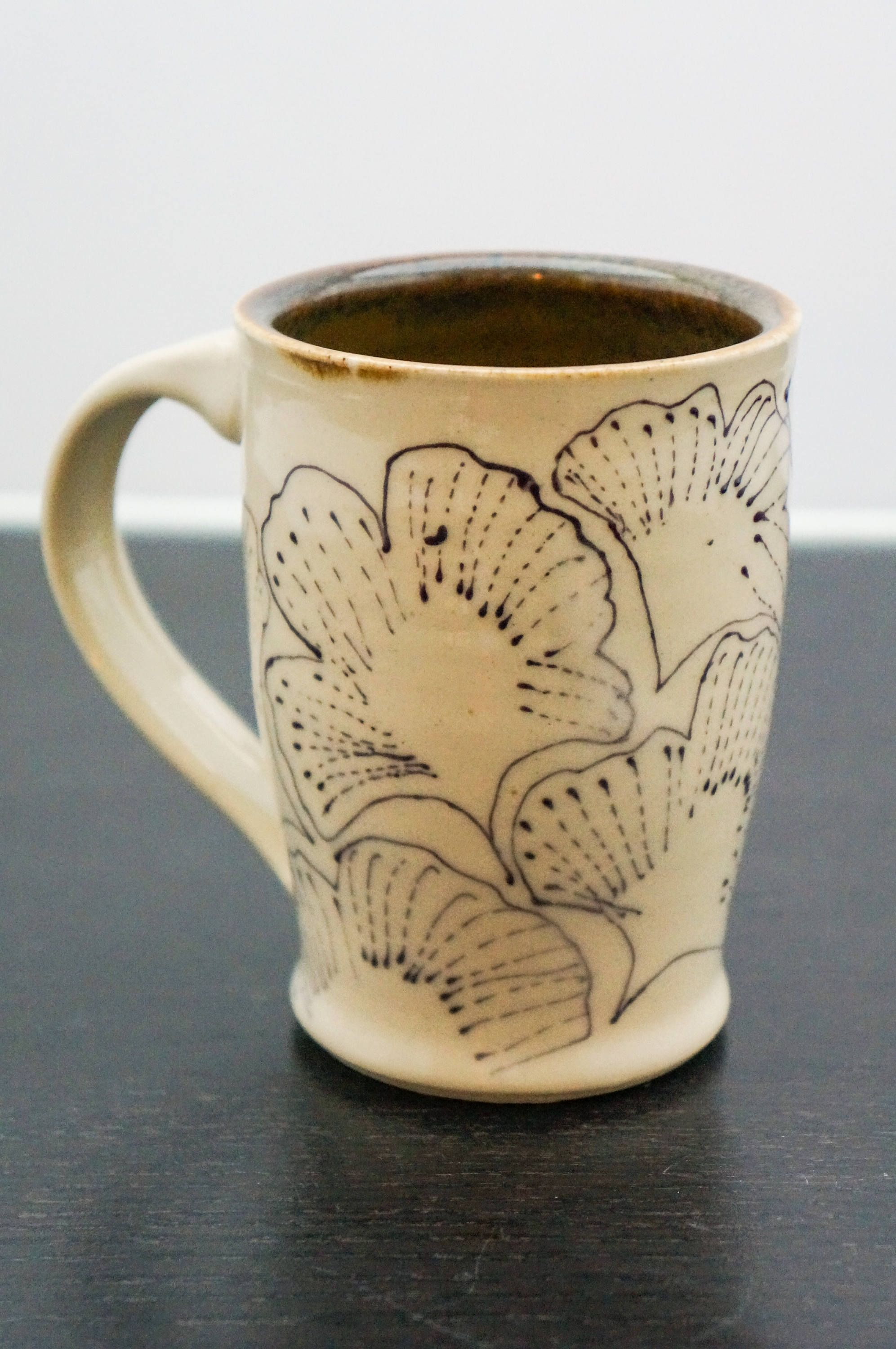 This Pottery Coffee Mug With The Gingko Design Would Make The Perfect Unique Gift For The Special Person In Your Life Pottery Coffee Mug Pottery Ceramics Mugs