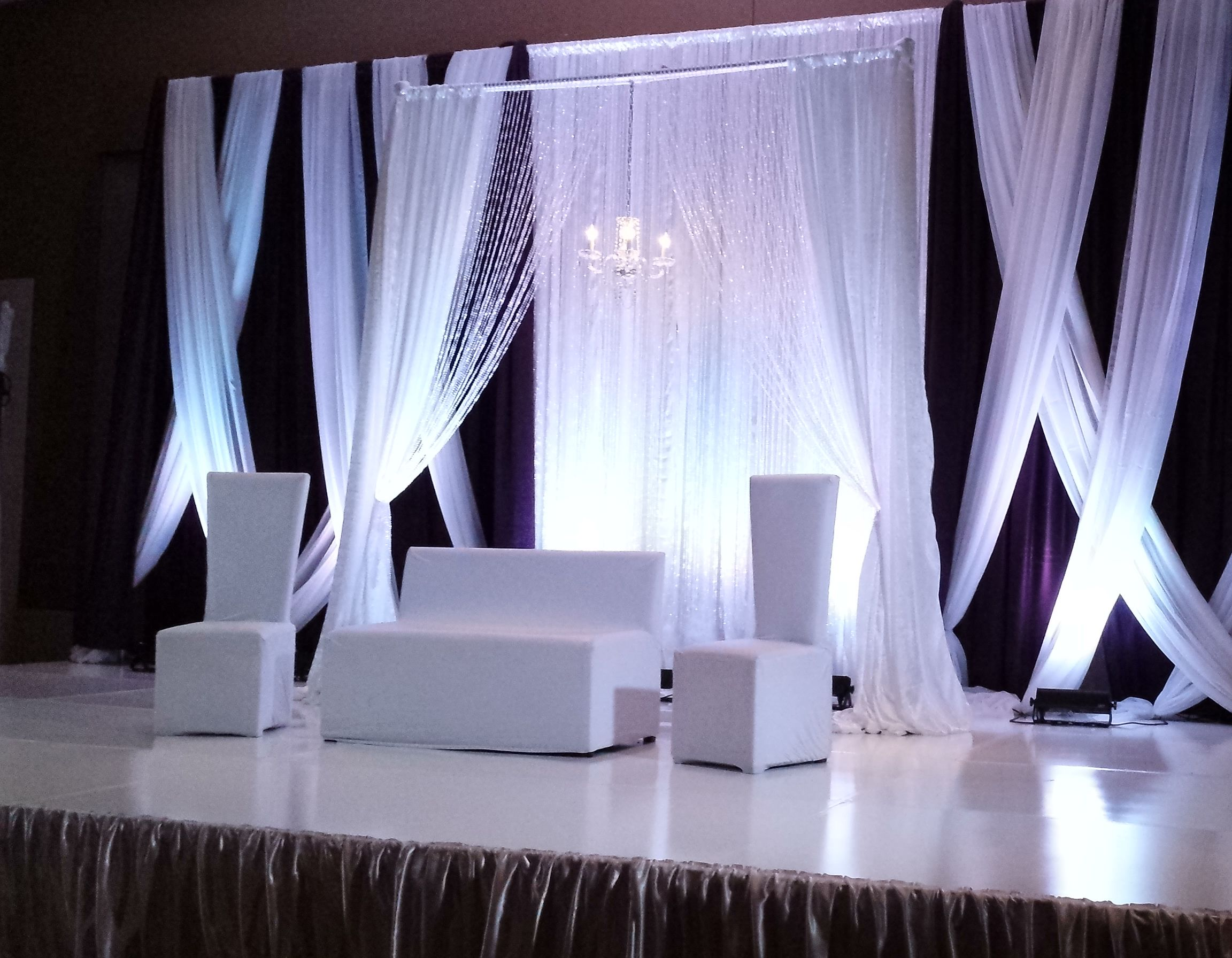 Plum curtains - White Plum Backdrop With White Criss Cross Crystal Curtains And Hanging Chandelier White Lounge