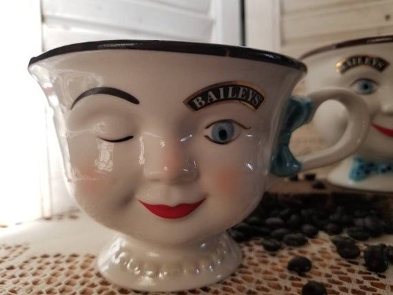 These are great! Both have the Baileys Insignia including the gold rim over their open eye. He features a blue polka dot bowtie with his great smile. She has a bow in her hair and is wearing pearls.These great Baileys Irish Cream mugs have been around for many years and this pair looks brand new!These would be great to Adorn your coffee bar! Yum!