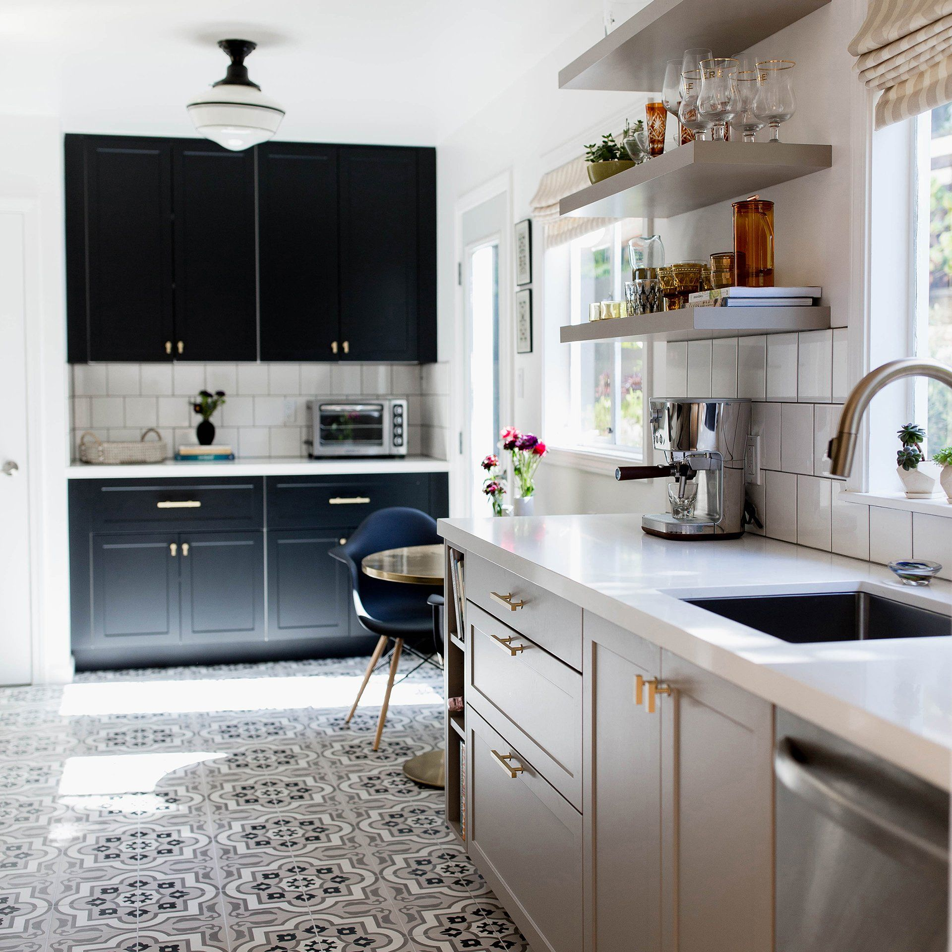 A Smart Two Tone Kitchen In Oakland Hills Waterfall Countertop Kitchen Cabinet Trends Black Kitchen Cabinets