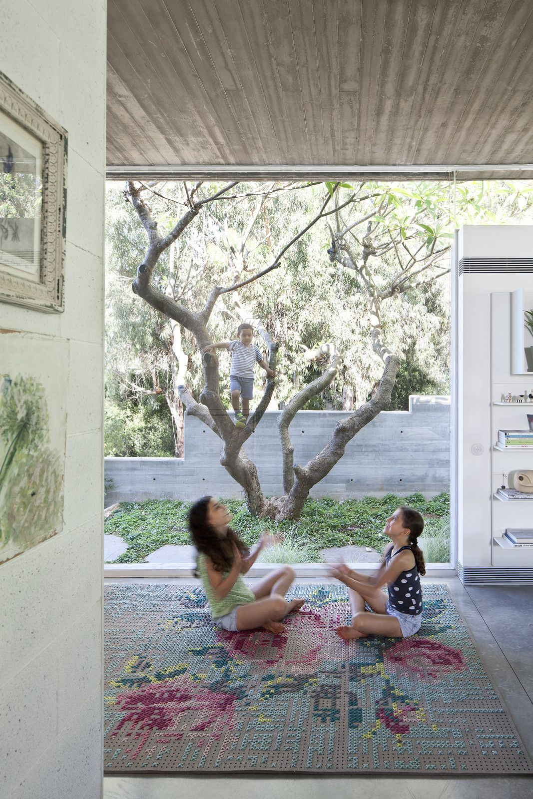 An Architect's Bright and Airy Family Home Thrives Within a Brutalist Concrete Structure - Photo 10 of 13