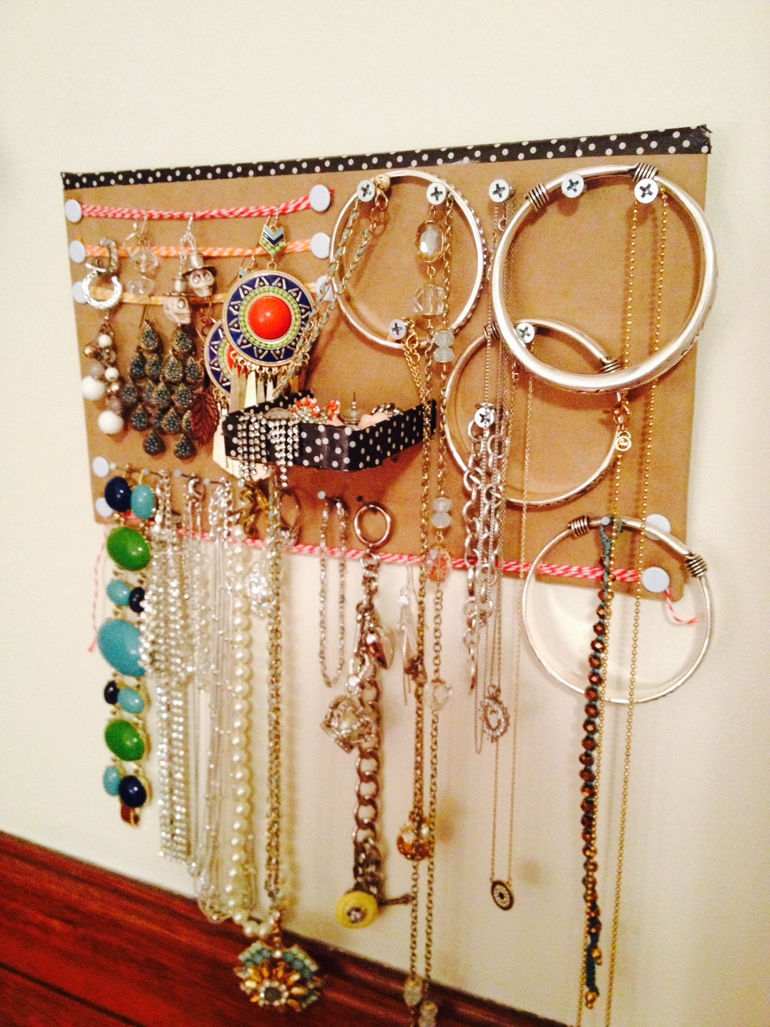 Homemade Hanging Jewelry Organizer stacked cardboard covered in