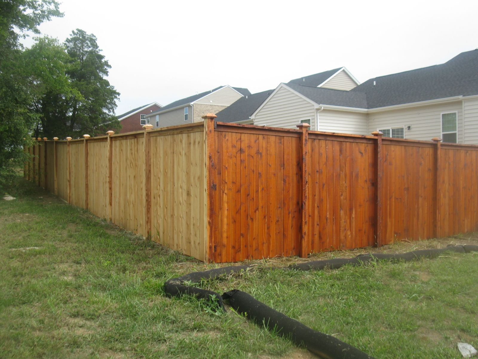 Before And After Our Cedar Tone Fence Stain And Seal On A Cedar And Cypress Cap And Trim Style Privacy Fence In Mt Juliet Tn Fence Stain Fence 1960s House