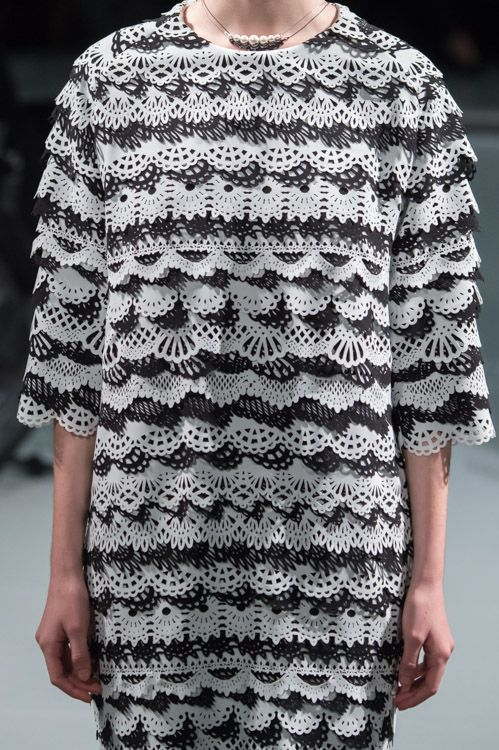 Laser cut dress with black & white patterns + texture; monochrome fashion details // Anrealage S/S 15