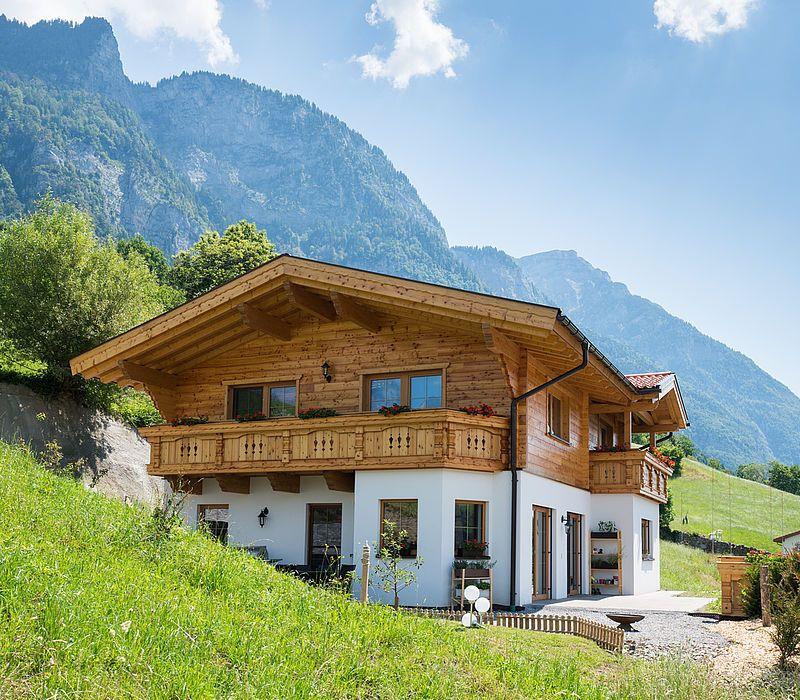 Photo of Tiroler Kombihaus / Riegel-Block-Hauskombination bauen