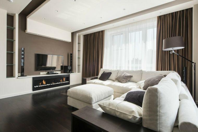 Arredamento Moderno Bianco E Tortora.Arredamento Salotto Con Camino Moderno Tv A Parete Divano E Puff