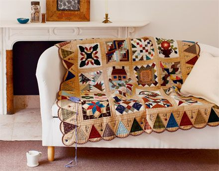 Quilt with patchwork and embroidery on a couch