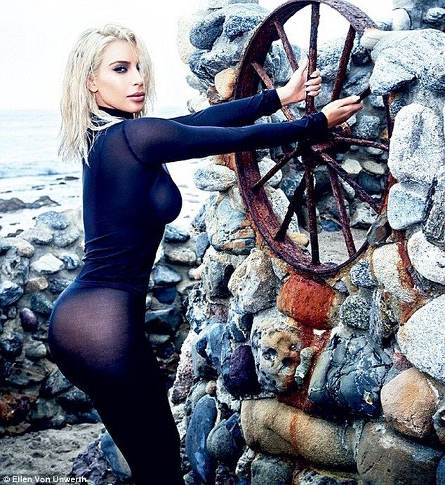 97169a8383bd Outdoorsy  In another image from Kim Kardashian s cover shoot with Vogue  Brasil the star can be seen in a sultry shot on a windswept beach wearing a  sheer ...