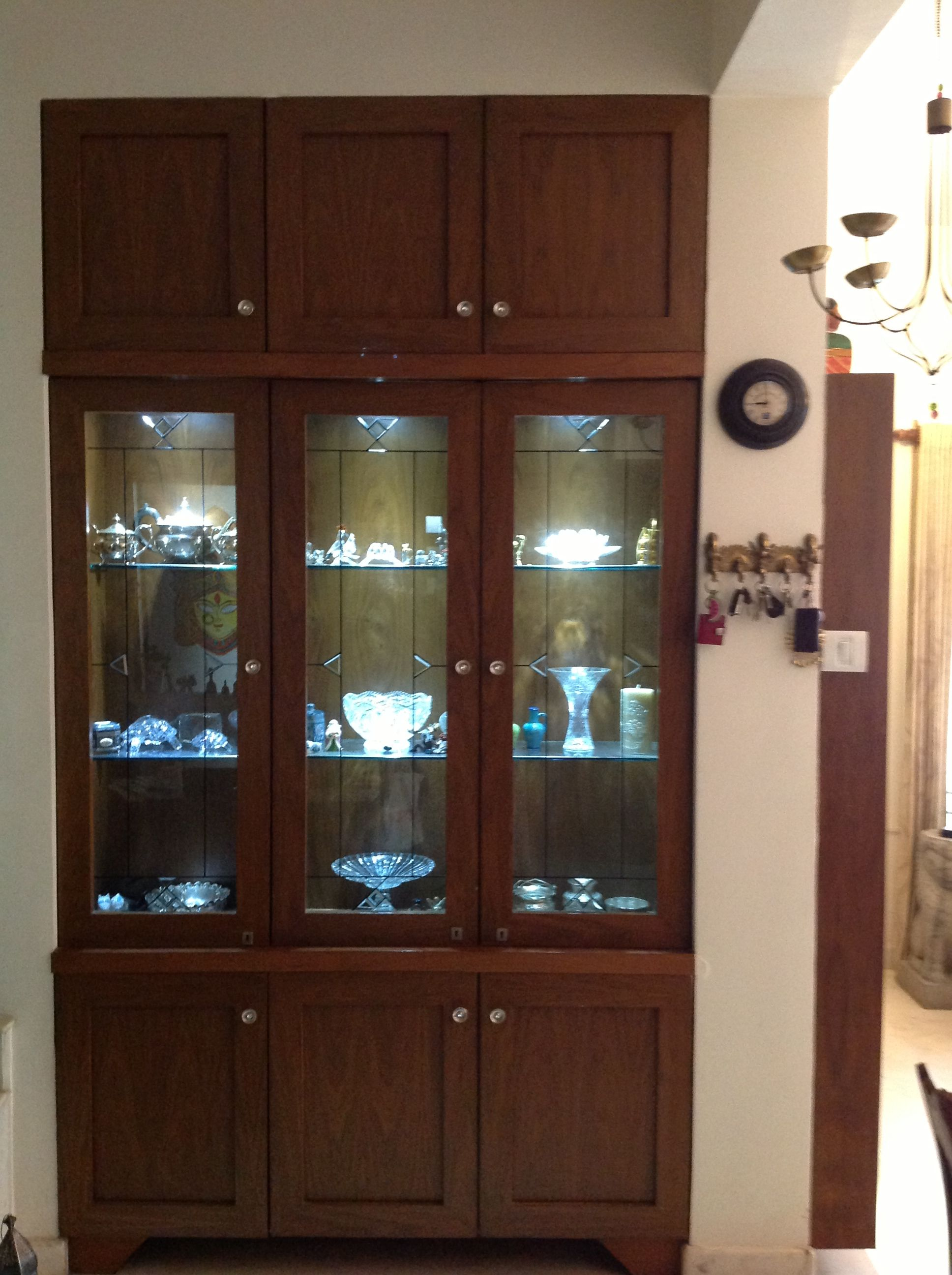 Crockery unit made to order in a niche that existed along for Modern cupboard designs