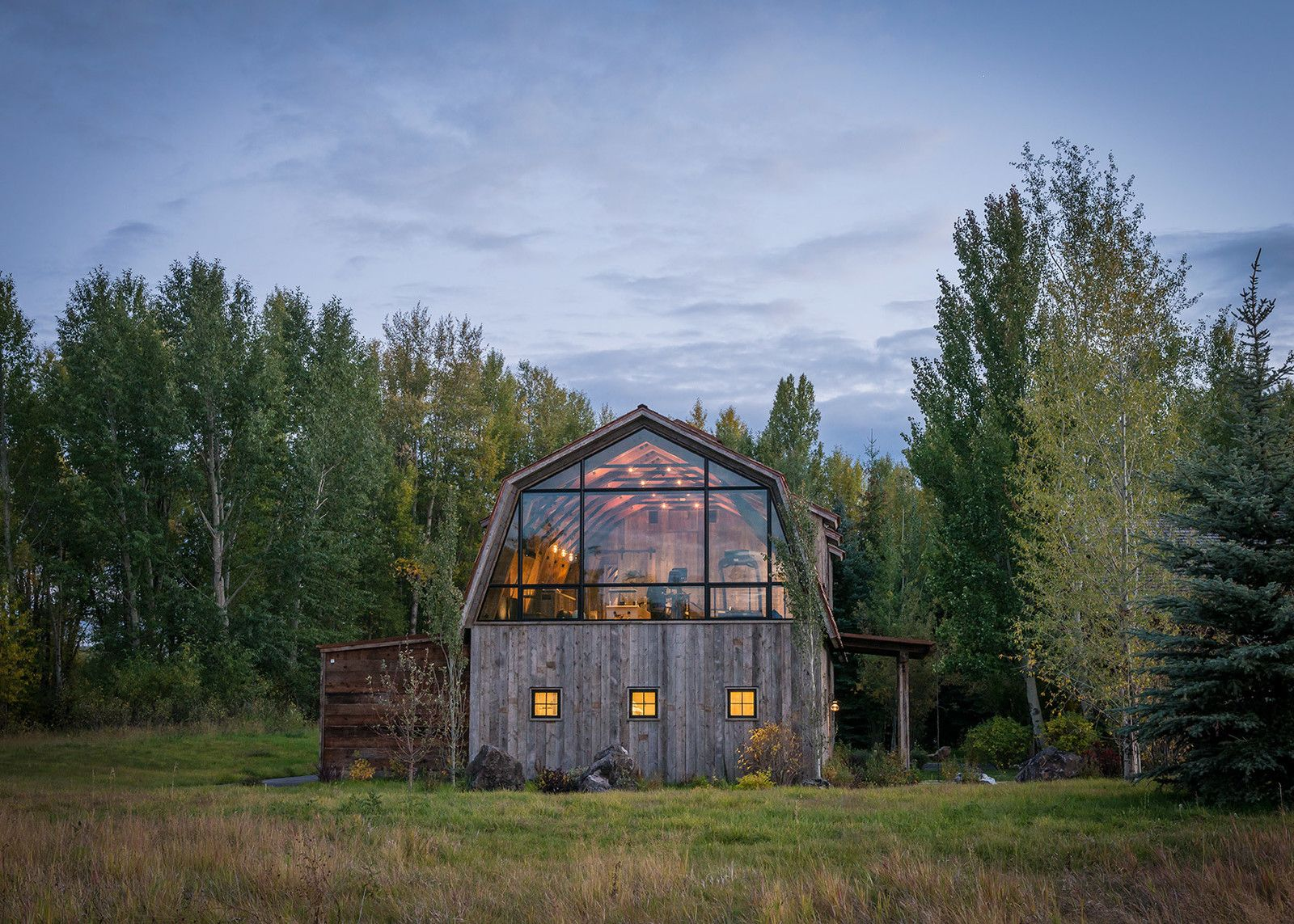 This modern take on the rustic barn offers a unique space for guests to soak in the gorgeous mountain vistas near Jackson, Wyoming.