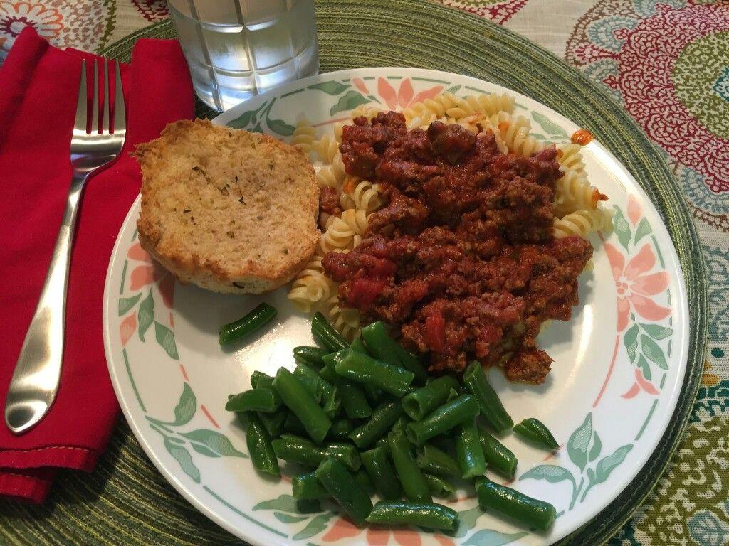 Rotini noodles, Pasta sauce, frozen beans, 1.5lb Hamburger, leftover buns with garlic butter