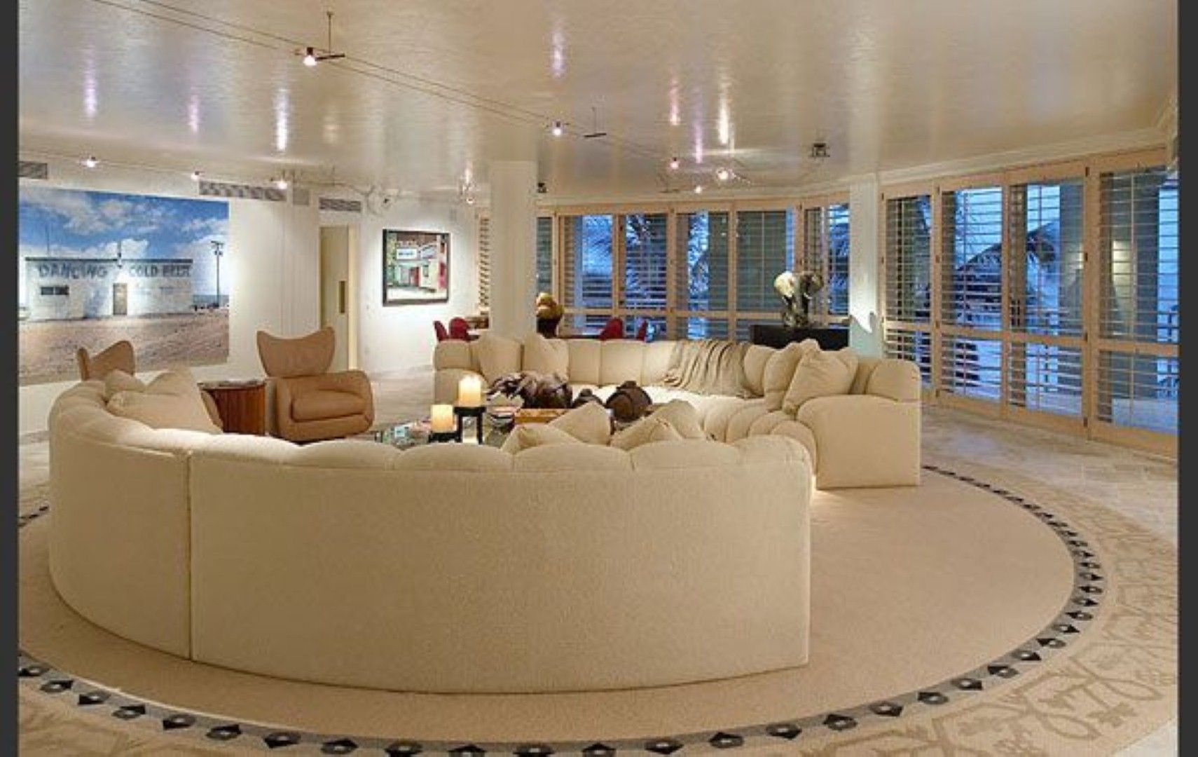 here is an interesting round living room layout. i just love