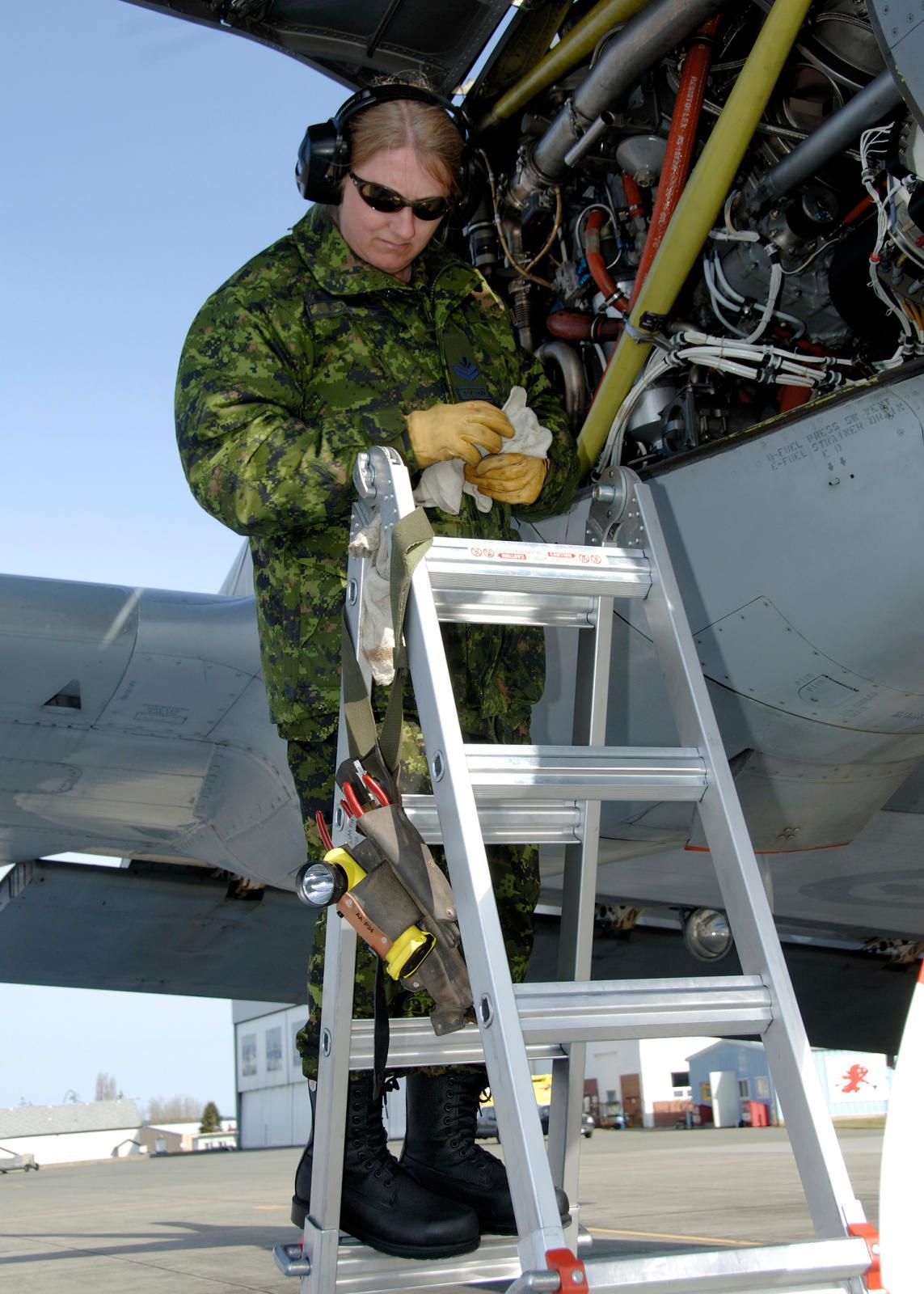 Master Corporal Theresa Vlaar An Aviation Systems Technician Avn Tech With 407 Squadron Does A Pre Flight Check On The Aurora Aircraft Photo Canadian Forces