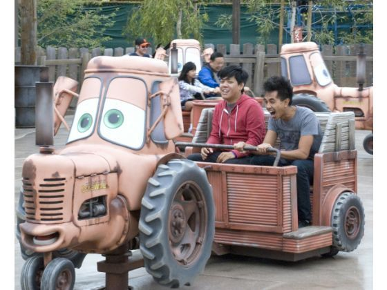 Two annual passholders enjoy a ride on Mater's Junkyard Jamboree, a crack-the-whip ride in Cars Land at Disney California Adventure.