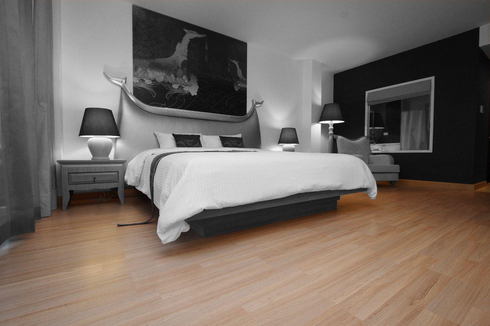 Light Brown Laminated Wood Flooring In A Bedroom Unit Home Flooring Wood Floors
