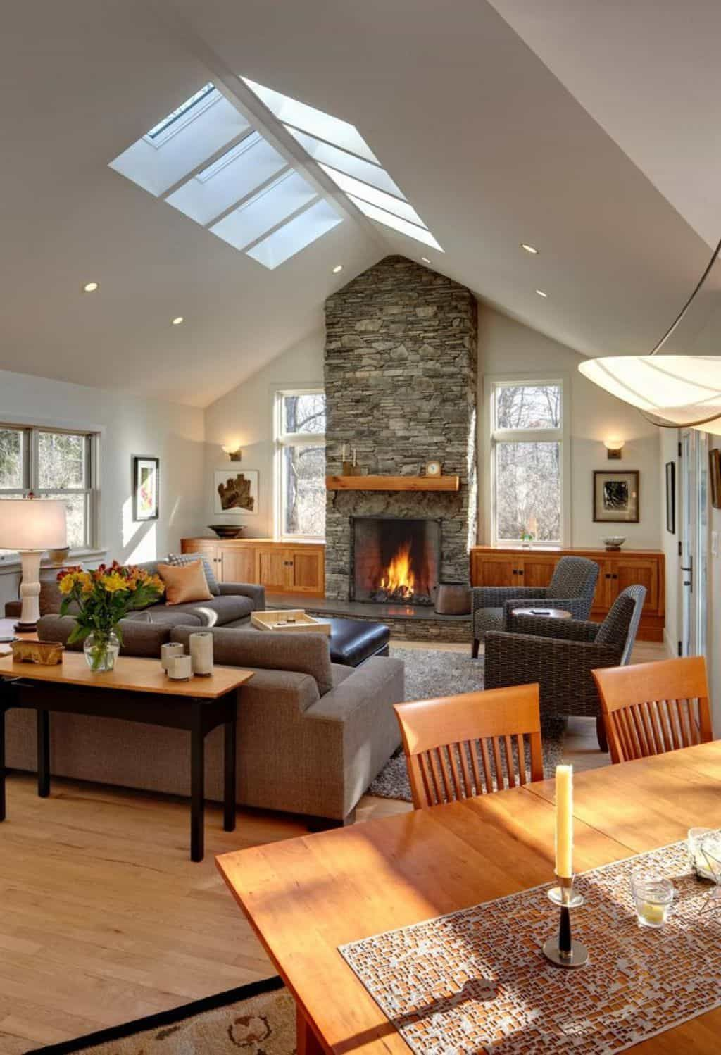 Comfortable Living Room Designed With Stone Fireplace And Skylights Also Recessed Lights images